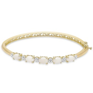 Dolce Giavonna Gold Overlay Simulated Opal and Diamond Accent Bangle