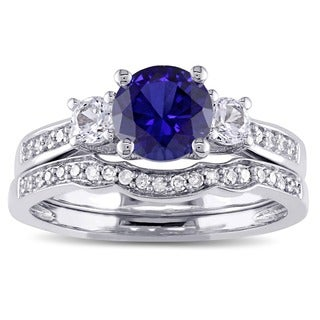 Miadora 10k White Gold Created Blue and White Sapphire and 1/6ct TDW Diamond 3-stone Bridal Ring Set (G-H, I2-I3)