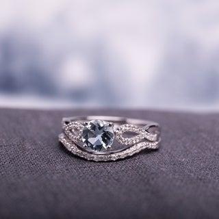 Miadora 10k White Gold Aquamarine and 1/6ct TDW Diamond Bridal Ring Set (G-H, I1-I2)