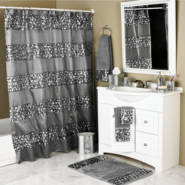 set includes one shower curtain and 12 rings texture home dynamix bath boutique shower curtain and bath rug set