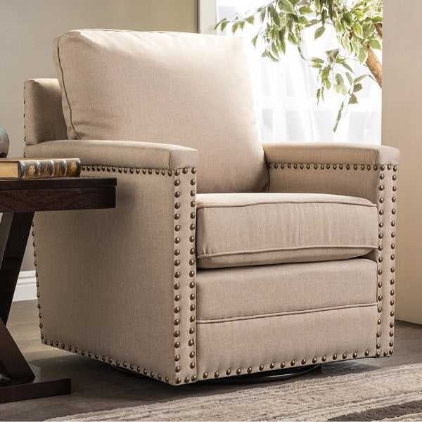 Baxton studio ashley contemporary beige fabric upholstered swivel armchair with bronze nailheads for Fabric swivel armchairs for living room