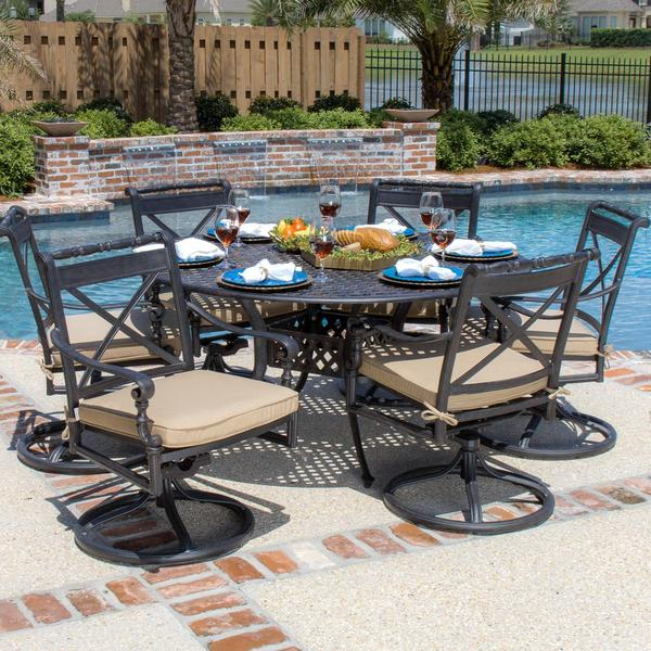 person cast aluminum patio dining set with swivel rockers and round