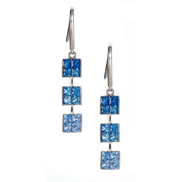 14k white gold earring with graduated sapphire.