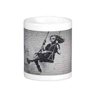 'Swing Girl' Los Angeles Banksy Art Coffee Mug