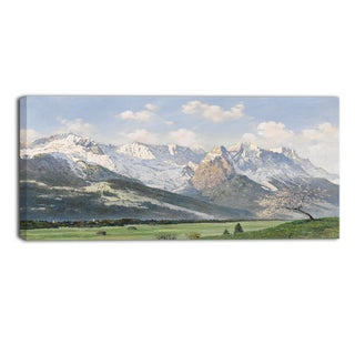 Design Art 'Glacial Mountains and Green Grass' Canvas Art Print - 32x16 Inches