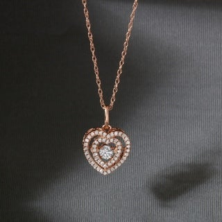 De Couer 10k Rose Gold 1/5ct TDW Diamond Heartbeat Necklace (H-I, I2)