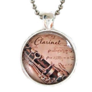 Atkinson Creations Clarinet and Vintage Sheet Music on a Beige Glass Dome Pendant Necklace