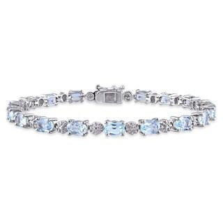 Miadora Sterling Silver Blue Topaz and Diamond Accent Tennis Bracelet