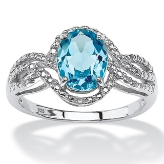 PalmBeach Platinum-over Sterling Silver 2 1/2ct TGW Oval-cut Blue Topaz Halo Crossover Ring