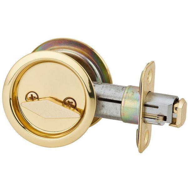 Kwikset Round Stainless Steel/Polished Brass Bed/Bath Handle Pocket Door Lock