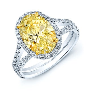 Platinum and 18k Yellow Gold 3 1/10ct TDW GIA Certified Fancy Yellow Oval Diamond Ring (H-I, SI1-SI2)