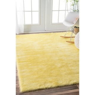 nuLOOM Cozy Soft and Plush Faux Sheepskin Shag Kids Nursery Yellow Rug (3' x 5')