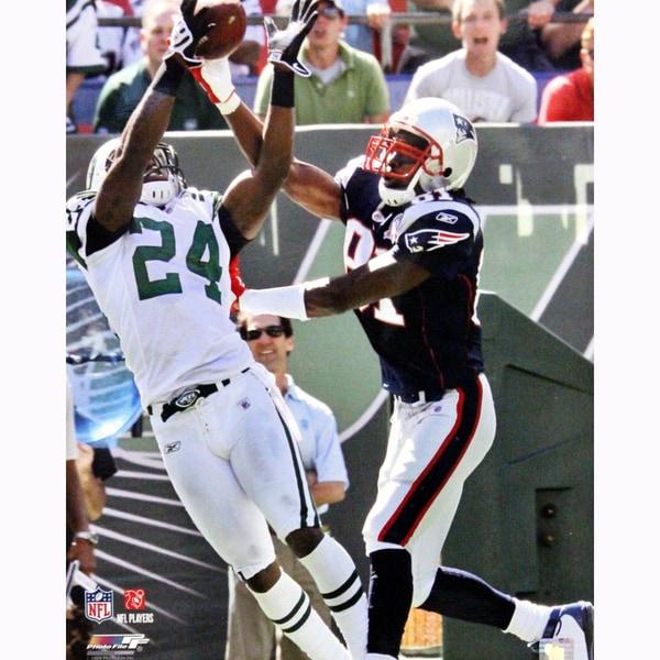 Darrelle Revis Interception vs Randy Moss of The New England Patriots Vertical 16x20 Photo 17301640
