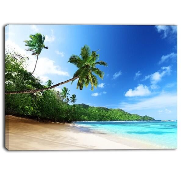 Designart - Sunset Beach with Palm - Landscape Photography Canvas Print