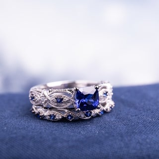 Miadora Signature Collection 10k White Gold Created Blue Sapphire and 1/10ct TDW Diamond Bridal Ring Set (G-H, I2-I3)