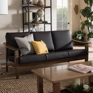 Baxton Studio Phanessa Mid-century Modern Walnut Wood and Dark Brown Faux Leather 3-seater Sofa