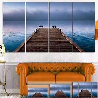 Designart 'Wooden Pier under Foggy Sky' Seascape Photo Canvas Wall Art