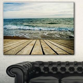 Designart 'Wooden Pier in Waving Sea' Seascape Photo Canvas Print