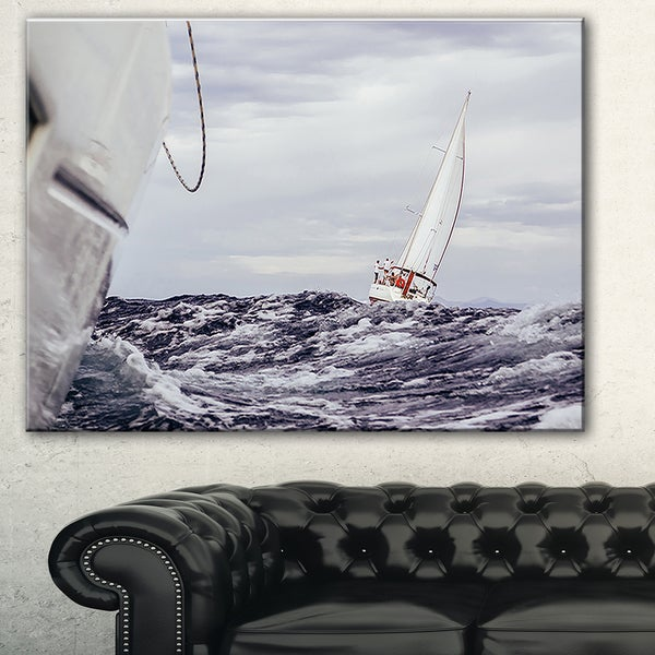 Designart 'Storm While Sailing' Seascape Painting Canvas Print