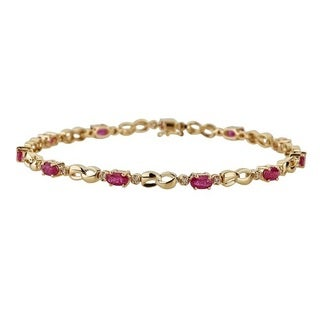 Anika and August 14k Yellow Gold Oval-cut Mozambique Ruby and 1/4ct TDW Diamond Bracelet (G-H, I1-I2)