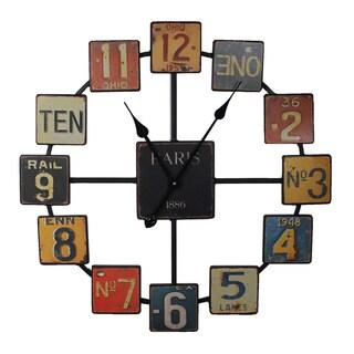 Uniquely Designed Metal Wall Clock By Entrada