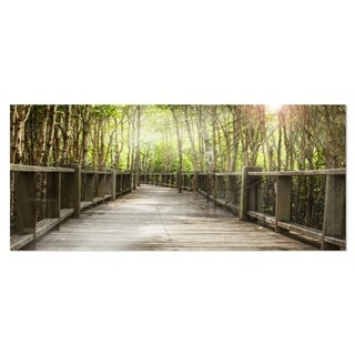 Designart 'Wooden Bridge in Forest' Landscape Photography Metal Wall Art