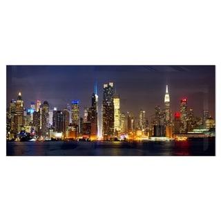 Designart 'New York Skyline at Night' Cityscape Photo Metal Wall Art