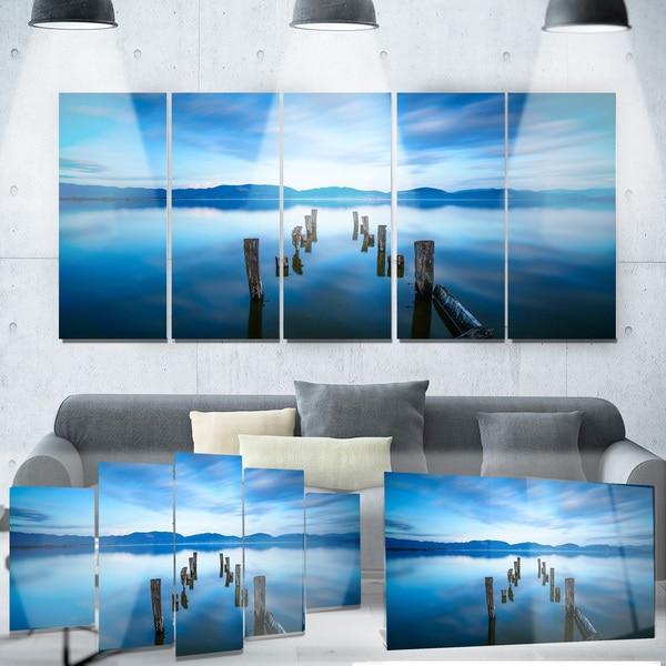 Designart 'Deep into the Sea Pier' Seascape Photo Metal Wall Art