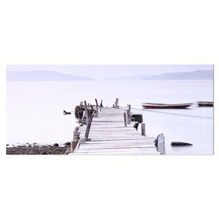 Designart 'Foggy Sea with Pier and Boats' Seascape Photo Metal Wall Art