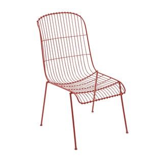 The Bright Red Metal Chair