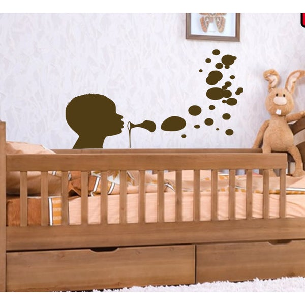 Boy blowing bubbles Wall Art Sticker Decal Brown