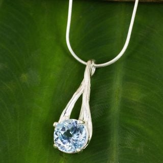 Sterling Silver 'A Singular Melody' Blue Topaz Necklace (Thailand)