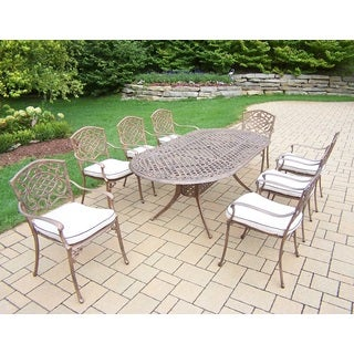 Explorer Cast Aluminum 84-inch x 42-inch 9-piece Dining Set With 8 Cushioned Stackable Arm Chairs