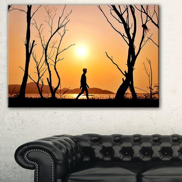 Man Walking Alone in Evening - Landscape Photo Canvas Artwork