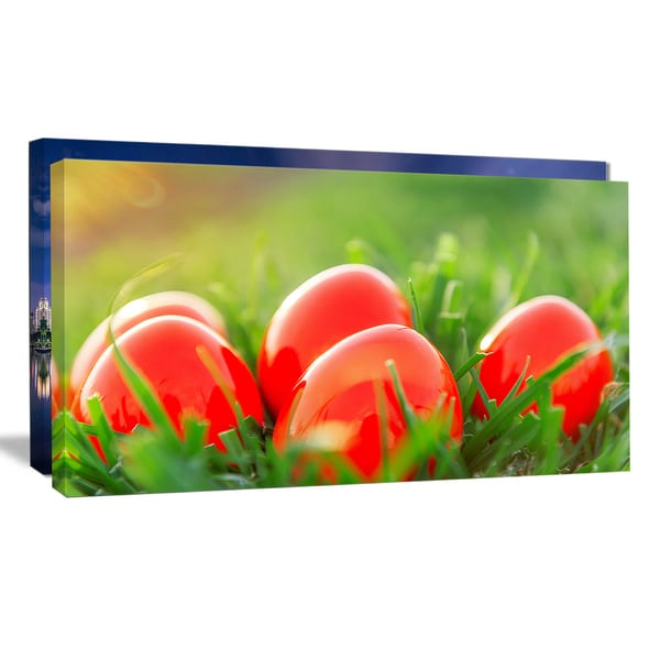 Red Easter Eggs in Green Grass - Landscape Photo Canvas Print