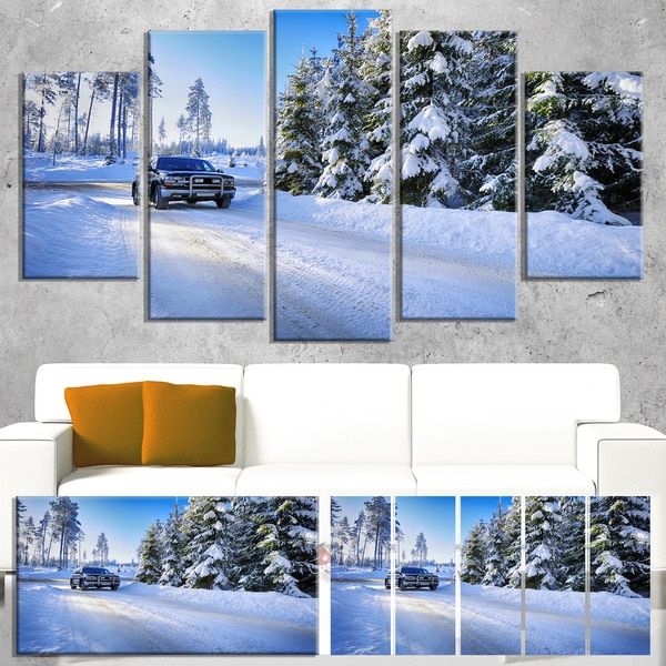 SUV in Rough Snow Terrain - Landscape Photo Canvas Print