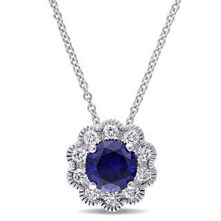 Laura Ashley 10k White Gold 1/4ct TDW Diamond and Created Blue Sapphire Flower Necklace (G-H, I2-I3)
