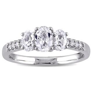 Miadora 10k White Gold Created White Sapphire 3-Stone and 1/10ct TDW Diamond Engagement Ring (G-H, I2-I3)