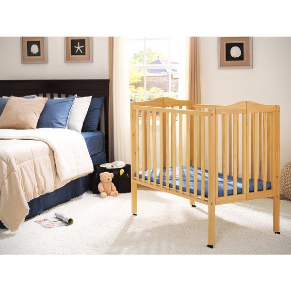 delta children natural finish portable crib photo