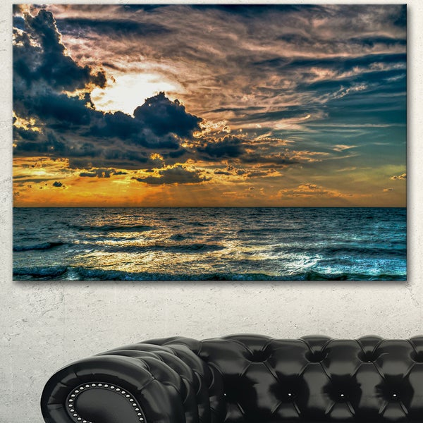 Designart 'Sun Break over Blue Ocean' Large Seashore Canvas Artwork Print