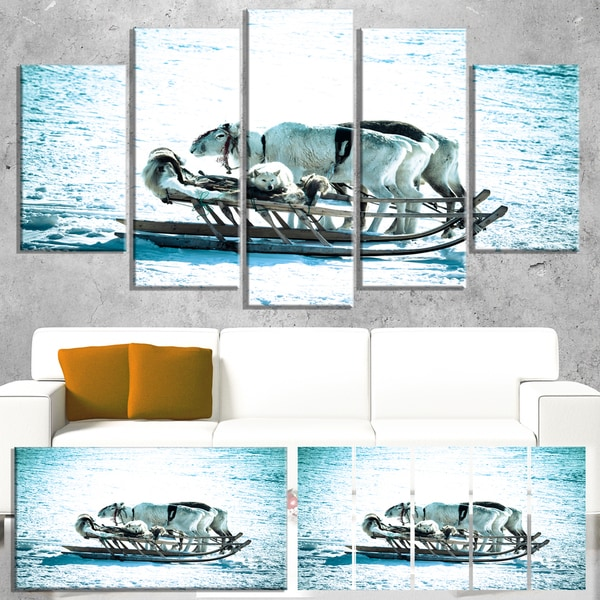 Designart 'Dogs on Reindeer Sleigh' Oversized Animal Wall Art