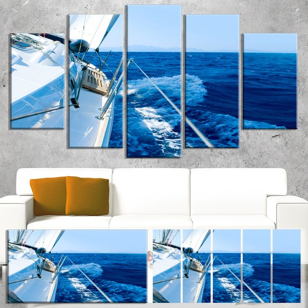 Designart 'Tourism Yacht Sailing in Blue Sea' Large Seashore Canvas Wall Art