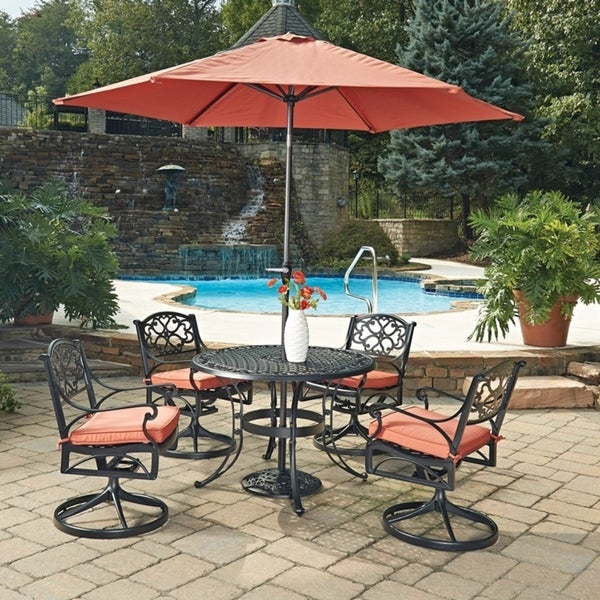 Biscayne Black Round 7 Pc Outdoor Dining Table, 4 Swivel Rocking Chairs with Cushions & Umbrella with Base by Home Styles 23778286