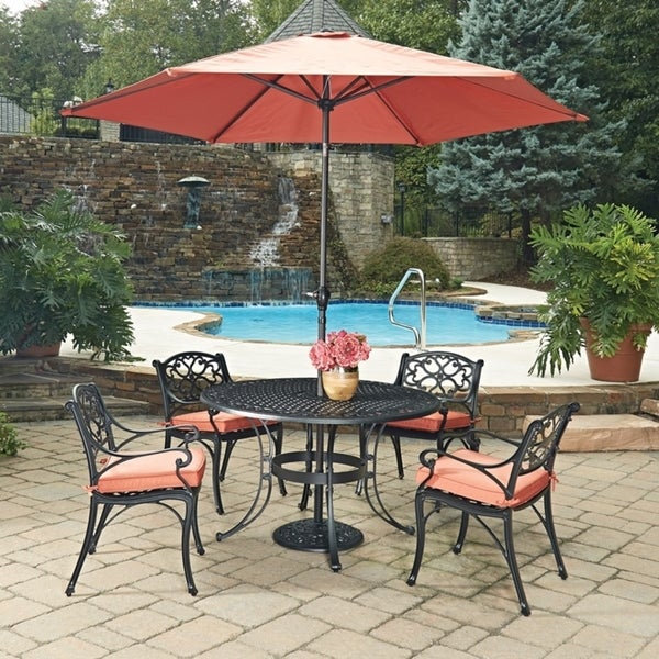 Biscayne Black Round 7 Pc Outdoor Dining Table, 4 Arm Chairs with Cushions & Umbrella with Base by Home Styles 23778456