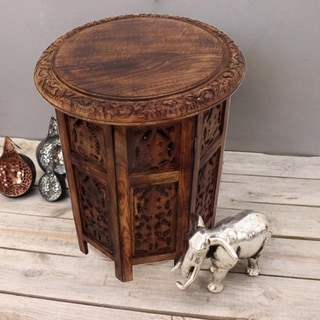 The Curated Nomad Grote Brown Hand-carved Wood Folding Accent Table
