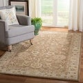 Handmade Ancestry Tan/ Ivory Wool Rug (8&#39; x 10&#39;)