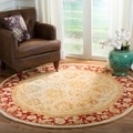 Handmade Ancestry Ivory/ Red Wool Rug (6' Round)