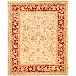 Handmade Ancestry Ivory/ Red Wool Rug (9' x 12')