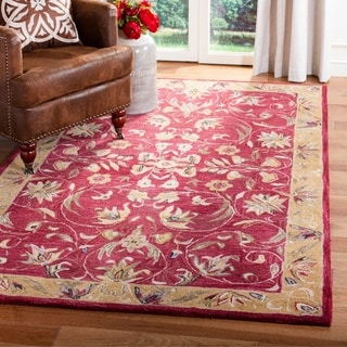 Handmade Hereditary Burgundy/ Gold Wool Rug (5&#39; x 8&#39;)