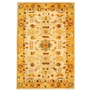 Handmade Tribal Ivory/ Gold Wool Rug (4' x 6')